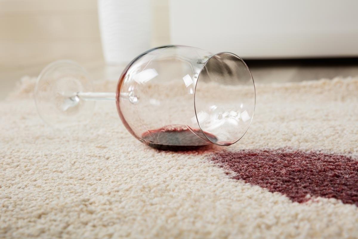 spilled red wine on white carpet